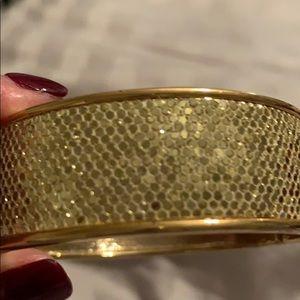 Gold tone wide bracelet